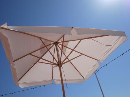 sun umbrella: a sun umbrella to protect because of the bright sun