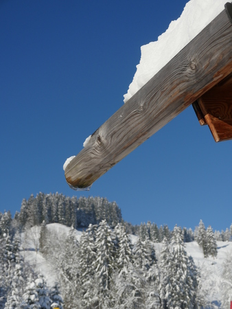 ski lodge: mountain hat in winter with snowflakes at christmas