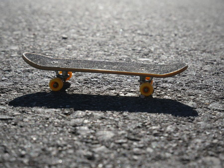 longboard: longboard skateboard on the tarmac