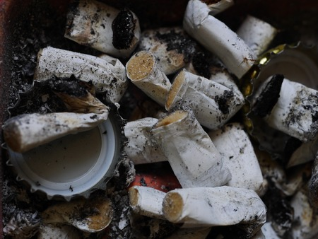 noxious: closeup of many dirty cigarettes butts background Stock Photo