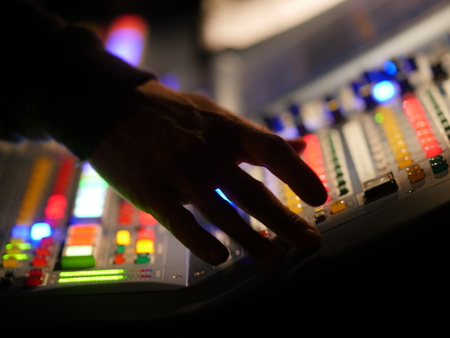 Colourful mixer with buttons and hand Stock Photo