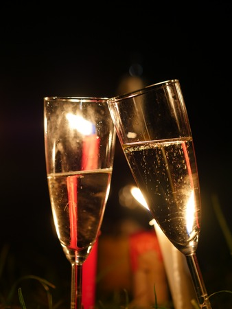 festive occasions: Glasses of champagne at firework on new years eve