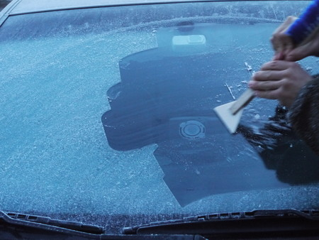 scraping: scraping snow and ice from the car windscreen