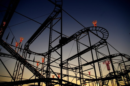 play the old park: Panoramic shot of a roller coasters loop at sunset.