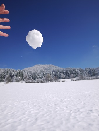 snowball: someone is throwing a big snowball Stock Photo