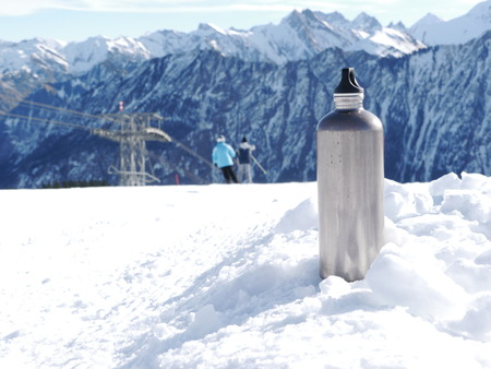 slope: a silver thermos flask on a slope