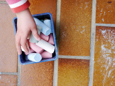 multi age: a child is playing with chalk