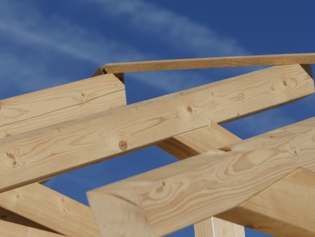 treated board: Wooden rafters against the blue sky Stock Photo