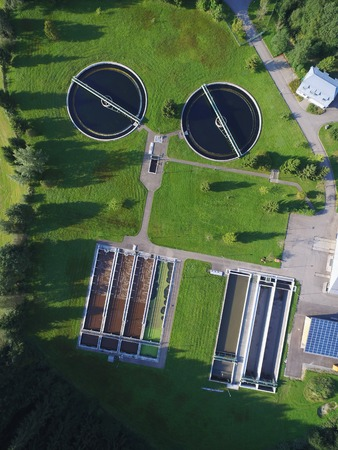 round eyes: Water treatment plant shot from high above, looking live a face with big round eyes
