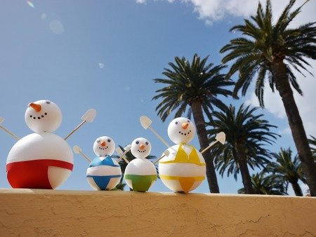 snowman beach vacation holidays from cold winter