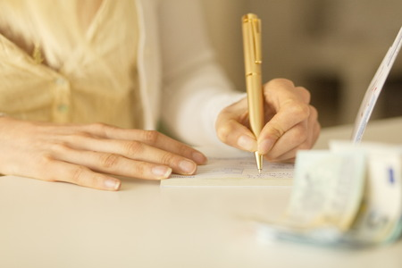 overdraft: Business woman Signing a cheque