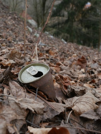 crushed cans: Rusty tin can on the dirty ground