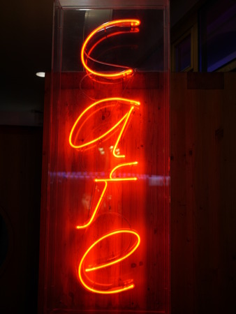 schriftzug: yellow orange lighting letters as sign for a cafe  Stock Photo