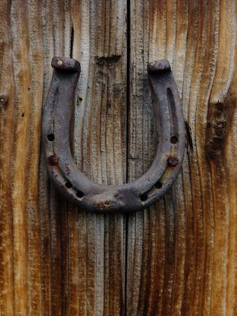 A Horseshoe Is Hanging On Wood Door Stock Photo   67811359