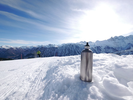 a slope: a silver flask on a slope Stock Photo