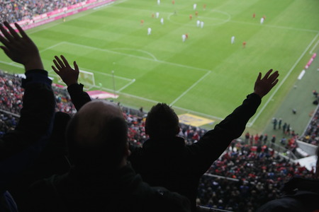 choleric: Soccer fans in a match. Furious spectators complaint about a bad decision of the referee. soccer supporters excitement Stock Photo
