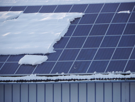 voltaic: solar cell on on roof producing electricity  with snow Stock Photo