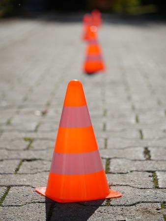 Orange traffic cones on road