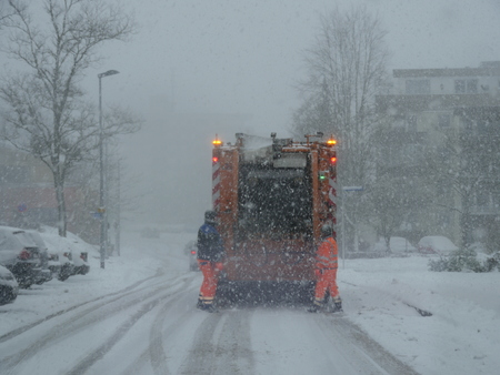 tree removal service: winter road clearance during snow storm Stock Photo