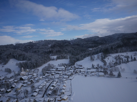 residential: aerial photo of village in winter
