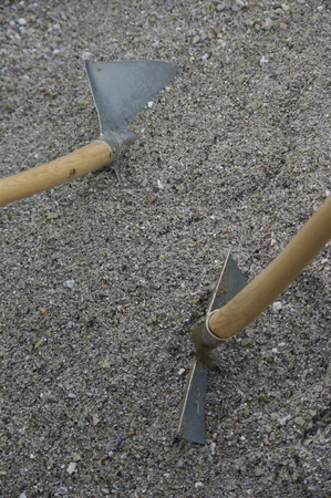 shovels in the sand Stock Photo