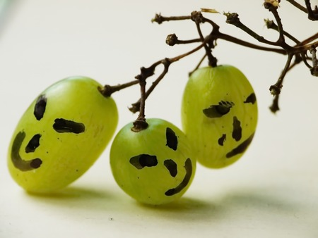 funny faces on grapes
