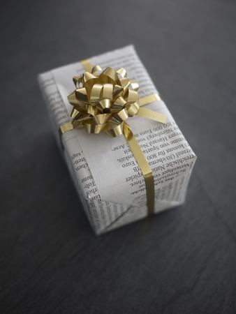 present  wrapped newspaper instead Archivio Fotografico