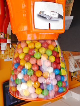 lot of gummy balls in a gummy ball machine Stock Photo