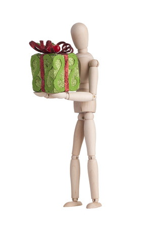 Wooden mannequin with gift