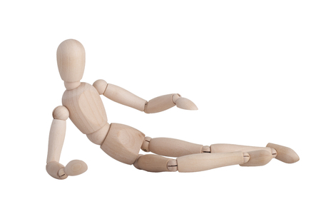 Wooden mannequin lying