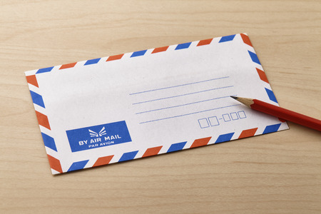 Air mail envelope on the wooden table