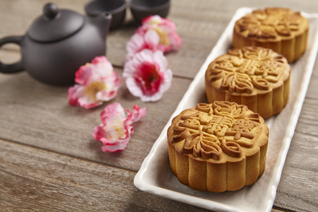 Chinese mid autumn festival foods, mooncake on wooden table