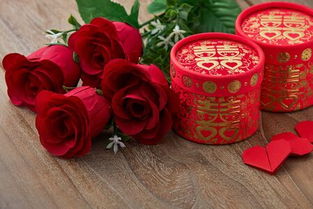 Chinese traditional wedding red heart rose on wooder table background, top view with copy space
