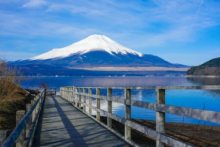 Mt. Fuji from a wooden path on the shore of Lake Yamanaka