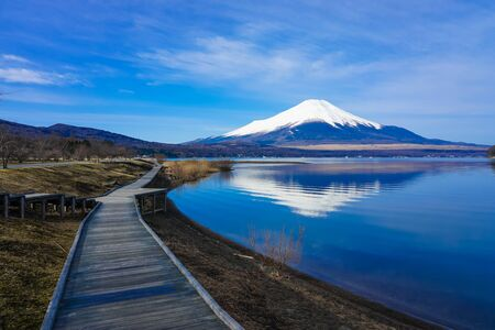 Mt. Fuji from a wooden path on the shore of Lake Yamanaka Stock Photo