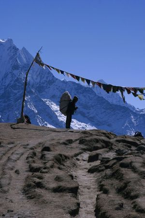porter: A porter praying at a stupa in the Himalayas.