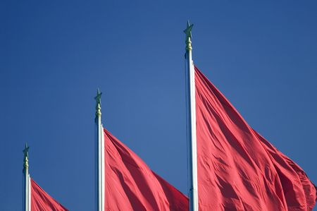 Red flags at Tiananmen Square in Peking. 에디토리얼