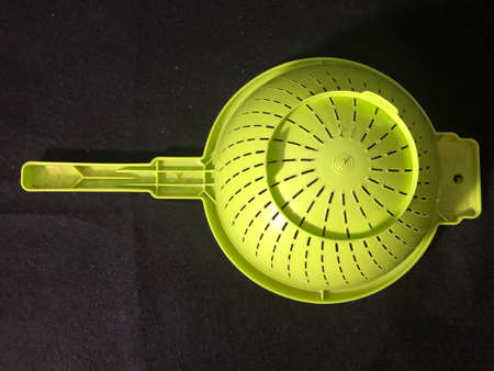 VEGETABLE STRAINER AND POETRY BOOKS