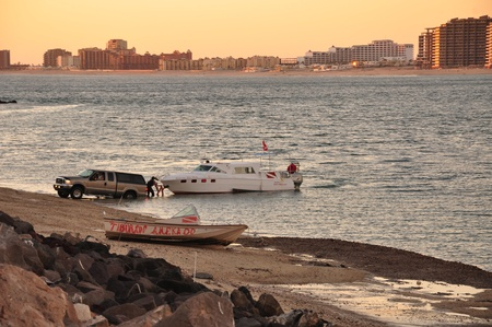 rocky point: A SUV towing a boat in Rocky Point, Mexico Stock Photo