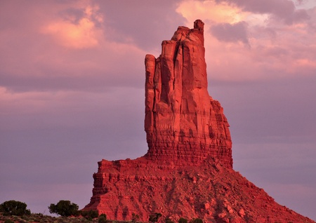 Monument valley rock in Arizona  resembles a hand in prayer skywards photo