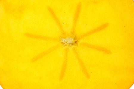 Closeup half of persimmon fruit (inside)