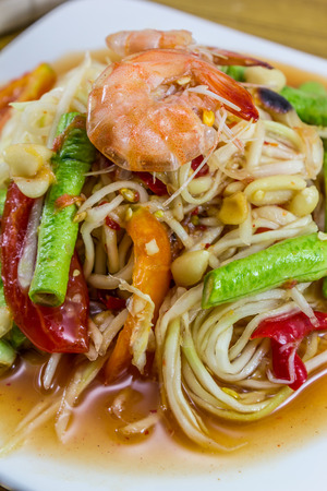 spicy papaya salad with peanut , dried shrimp and vegetable photo