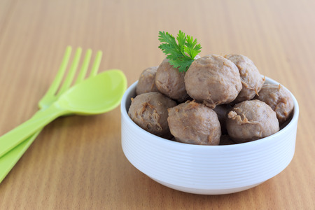 cooked pepper ball: meatballs on chopping board with  ingredient Stock Photo