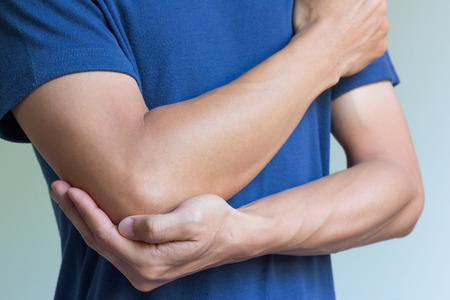 male massage: male having pain in injured arm