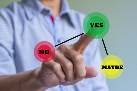 yes or no: Hand of businessman press Yes button. Concept of decision making. Stock Photo