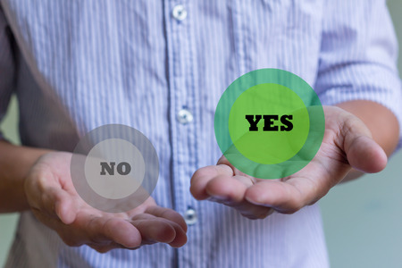 businessman holding word yes and no Stock Photo