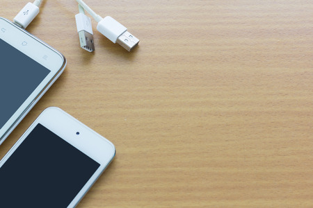 charger: smartphone with  charger and space for text