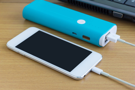 Smartphone is charging with power bank