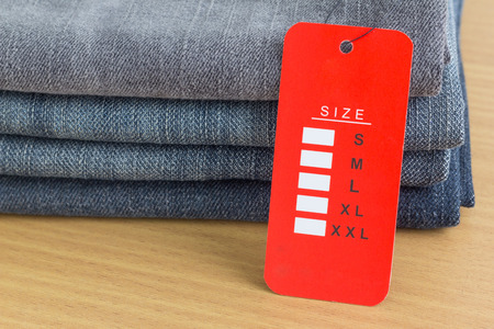 Red size tag on blue jeans