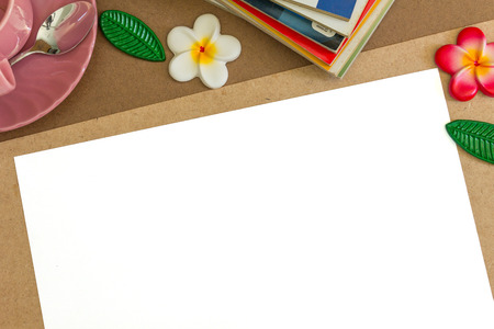 white notepaper and flower on wooden table